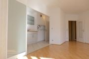 Obj.-Nr. 11180804 - Wohnzimmer seitlich zur Küche Essplatz