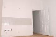 Obj.-Nr. 04190104 - Wohnzimmer mit offenem Küchenbereich